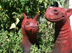 Garden decor - Carving of two smiling sea monsters