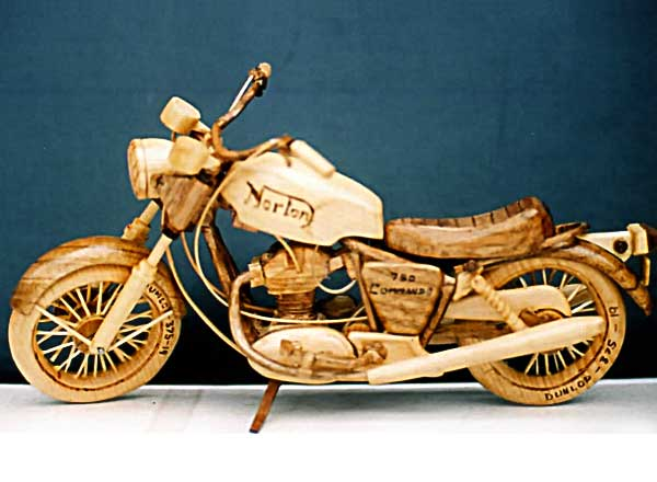 Carving of a Norton motorcycle