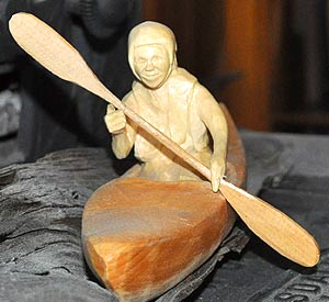 Carving of a kayaker